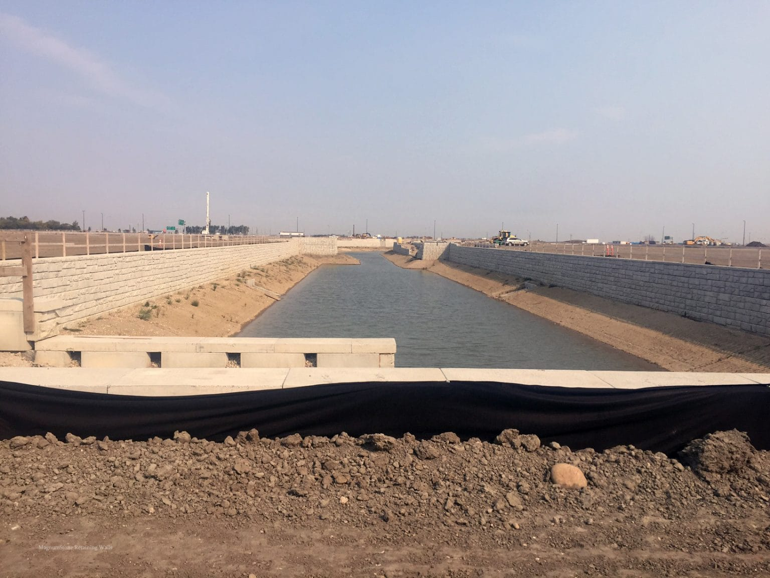 MagnumStone Geogrid Retaining Wall Edmonton Airport Water Application