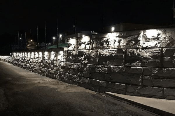 MagnumStone Retaining Wall Under Cap Lighting at Football Field
