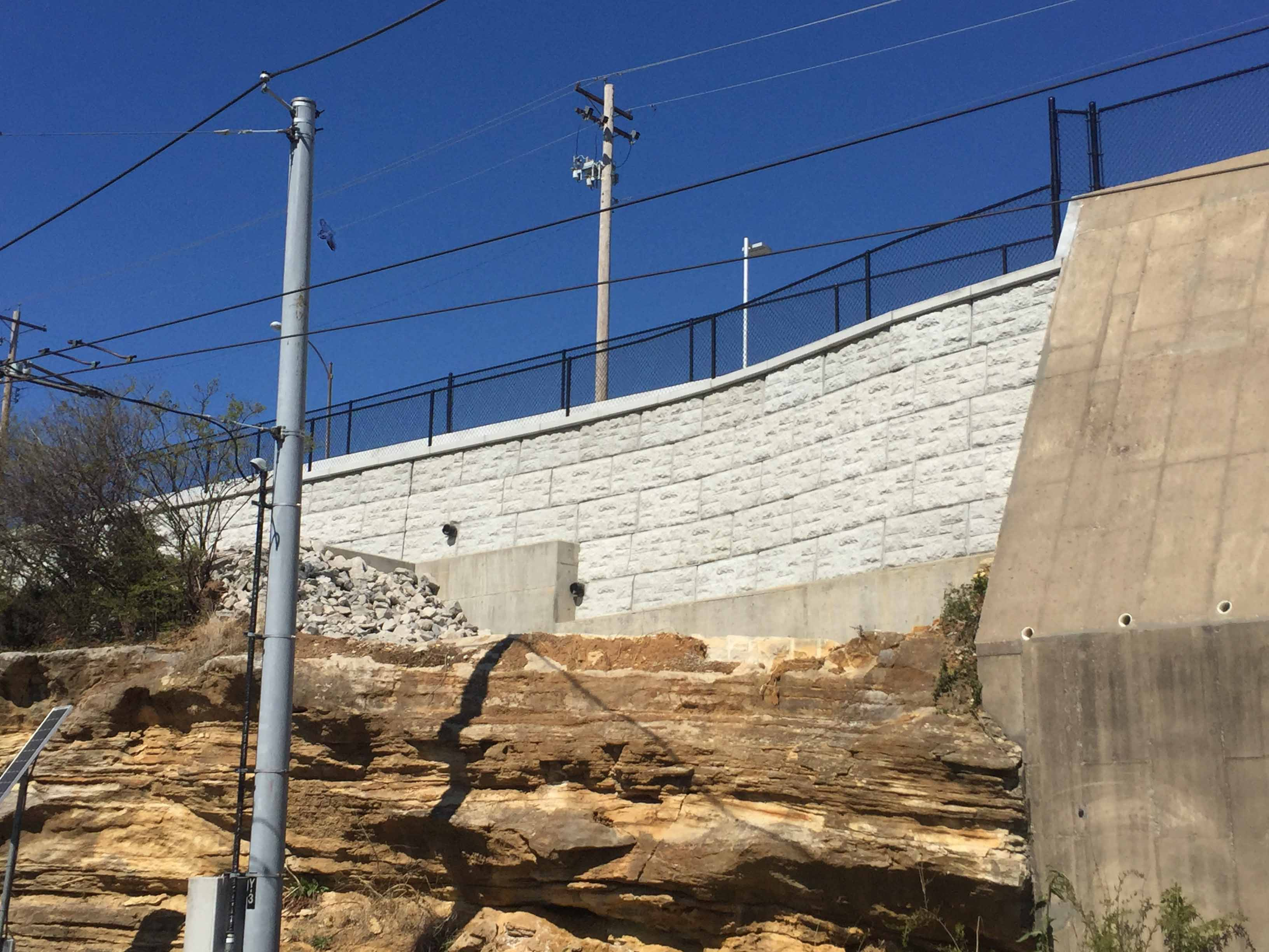 MagnumStone castle face retaining wall in st louis missouri with natural stone in front