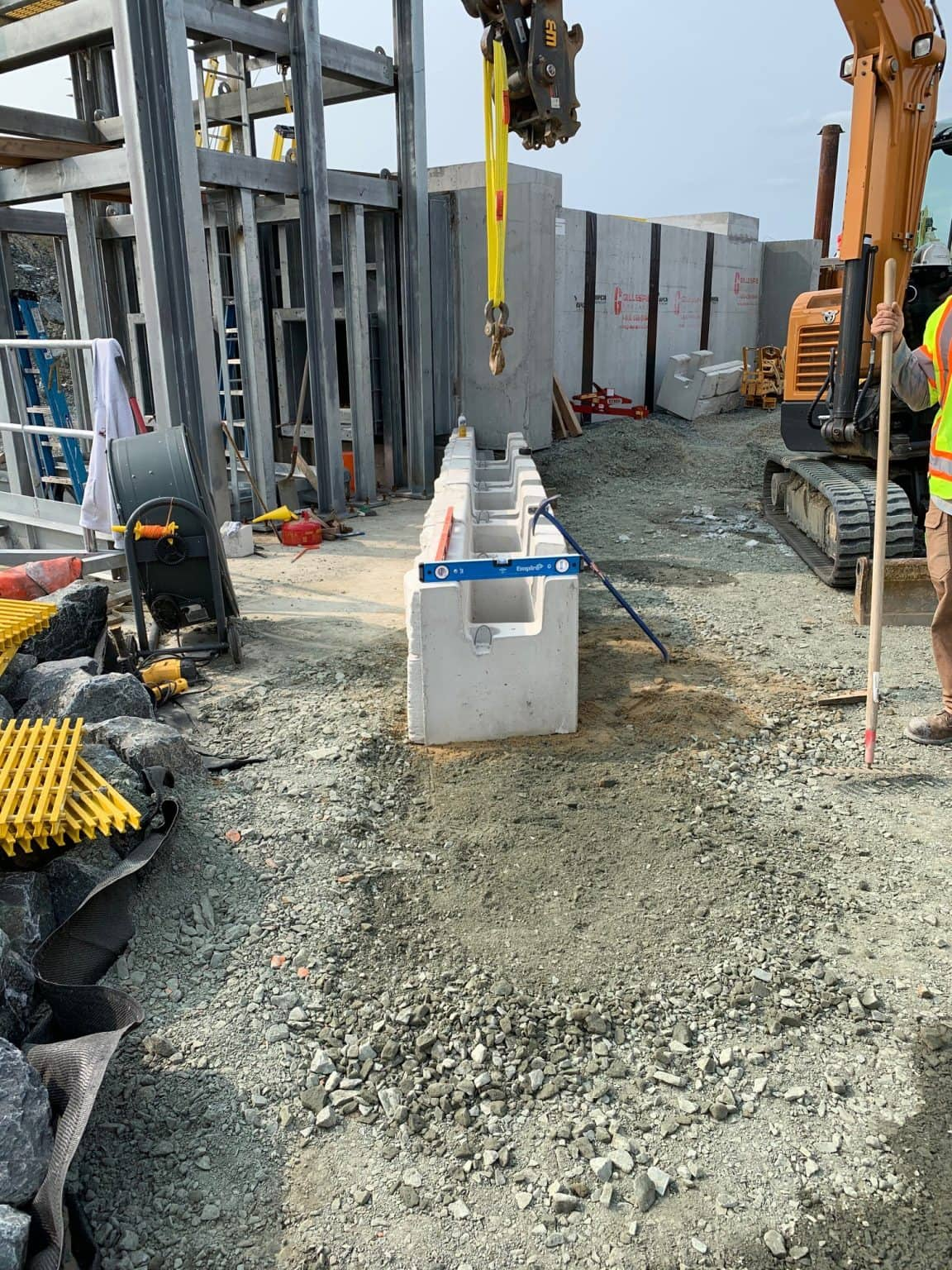 MagnumStone base units being installed on base levelling pad in a commercial application