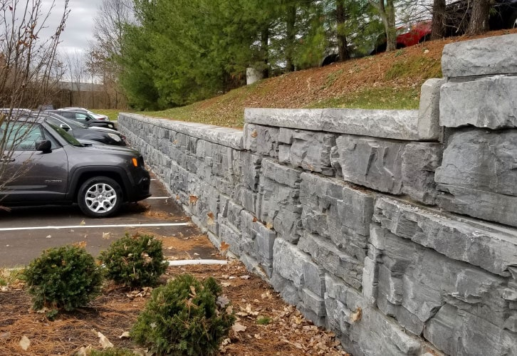 MagnumStone Gravity Retaining Wall Commercial Parking Lot, with a slope on top of the wall