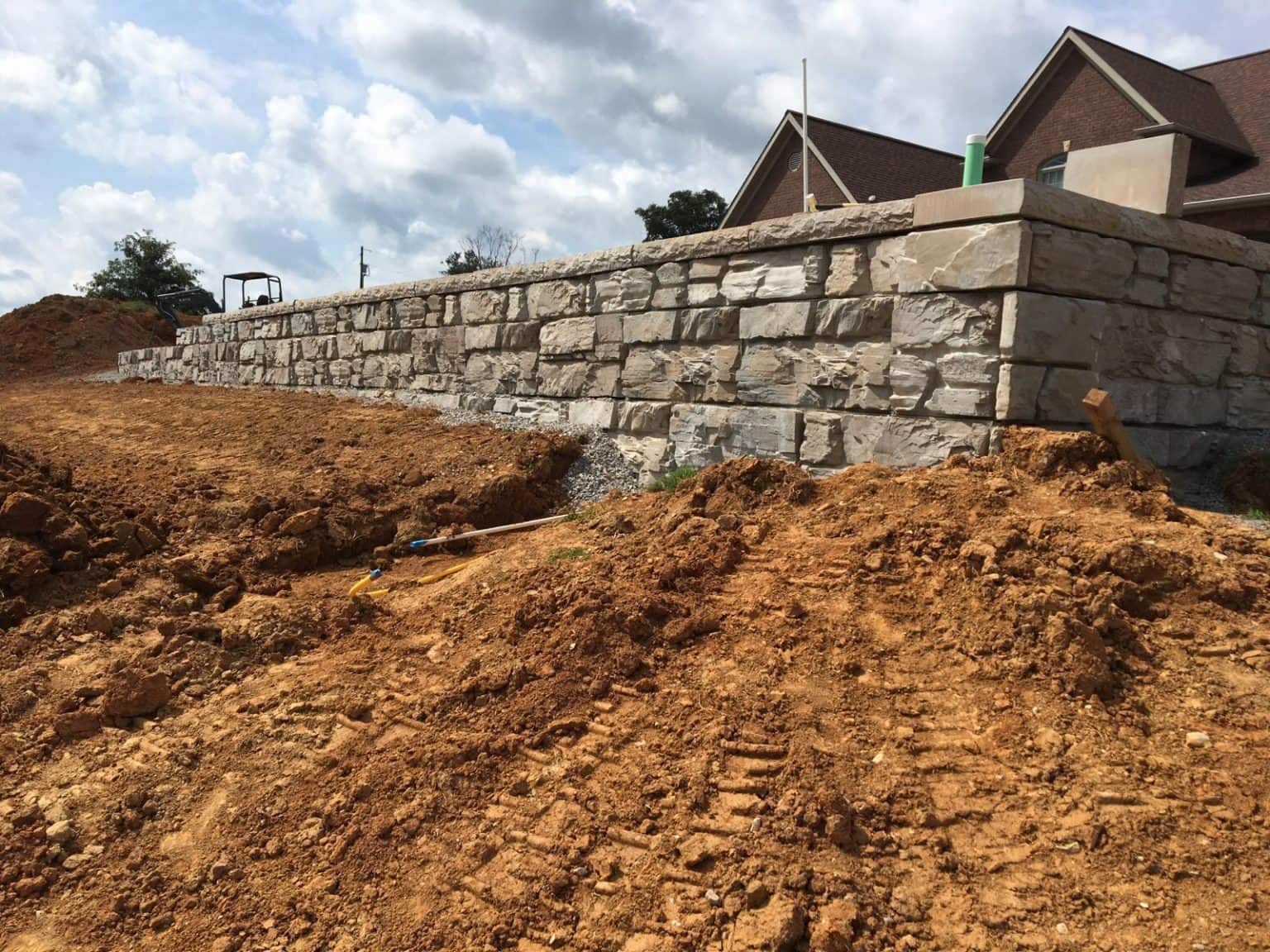 Installation of a Residential MagnumStone Ledge Face Retaining Wall In Kentucky